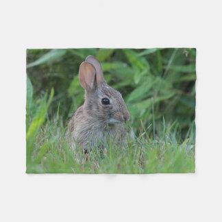 Bunny in the grass fleece blanket