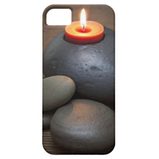 Burning candle flame with rocks in tranquil iPhone 5 covers