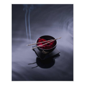 Burning incense on top of bowl of petals poster