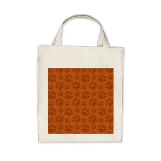 Burnt orange dog paw print pattern tote bag