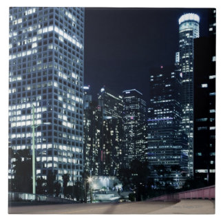 business district with big city lights during tile