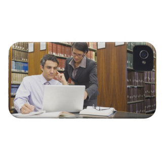 Business people doing research in library iPhone 4 cases