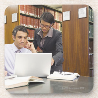 Business people doing research in library coaster