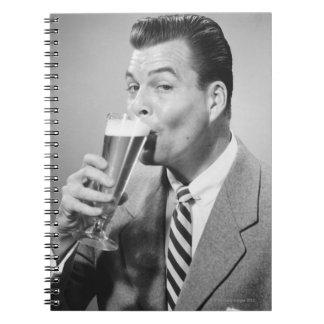 Businessman Drinking Beer Notebook