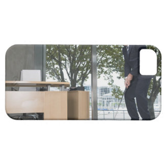 Businessman playing golf in an office iPhone 5 cover
