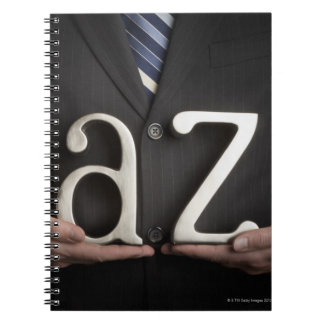 Businessman with A to Z letters Notebook