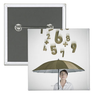 Businesswoman under umbrella with numbers and 15 cm square badge