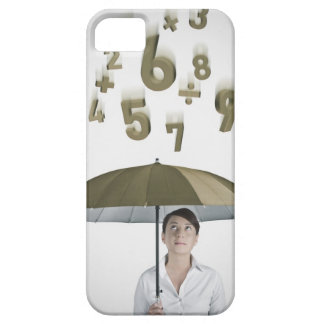 Businesswoman under umbrella with numbers and iPhone 5 cover