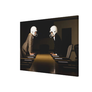 Businesswomen in face-off wearing football canvas print