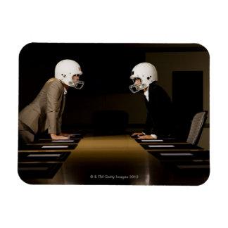 Businesswomen in face-off wearing football rectangular photo magnet