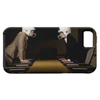 Businesswomen in face-off wearing football tough iPhone 5 case