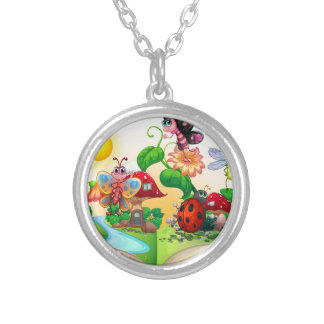 Butterflies and other insects in the book round pendant necklace