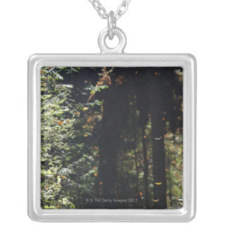 Butterflies flying in forest silver plated necklace
