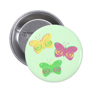 Butterflies on light green background 6 cm round badge