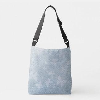 Butterfly design on faded denim look crossbody bag