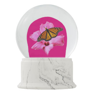 Butterfly on a hibiscus snow globes