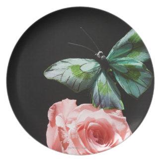 Butterfly on flower plate