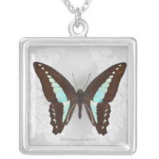 Butterfly on wallpaper background silver plated necklace