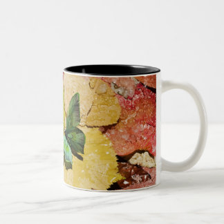 Butterfly on wet autumn leafs Two-Tone coffee mug