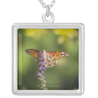 Butterfly on wildflowers silver plated necklace