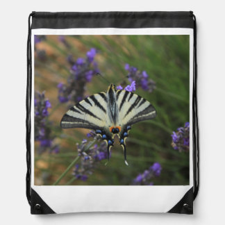Butterfly - Papilio machaon on flowering lavender Drawstring Bag