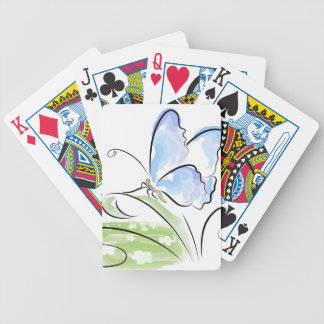 Butterfly sitting on grass over flower field bicycle playing cards