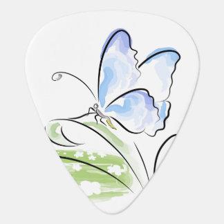 Butterfly sitting on grass over flower field guitar pick