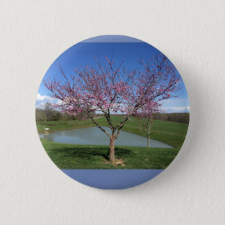 Button with beautiful picture of blooming tree