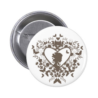 Button with decorative heart pattern