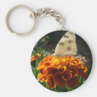 Cabbage white butterfly on a marigold key chain