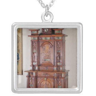 Cabinet with two sections, and a double door silver plated necklace