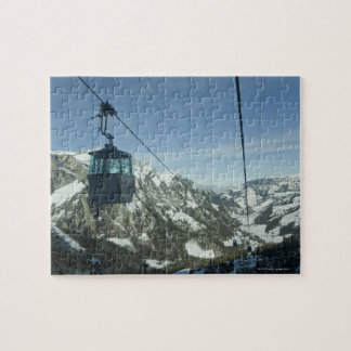 cable cars travelling through snowy mountainous jigsaw puzzle