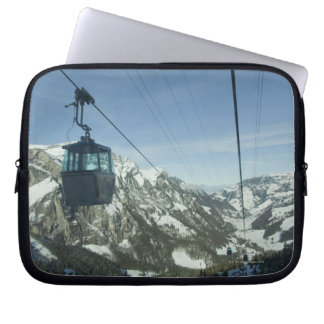 cable cars travelling through snowy mountainous laptop sleeve