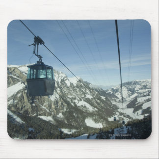 cable cars travelling through snowy mountainous mouse mat
