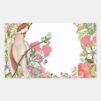 Cacatúa rosa sobre manto de flores rectangular altavoz
