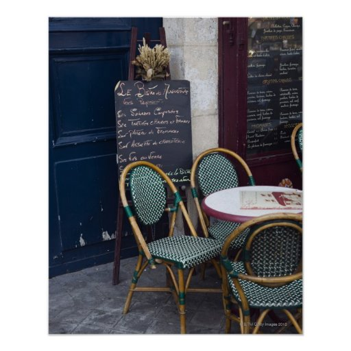 Cafe table with cane chairs in Paris, France