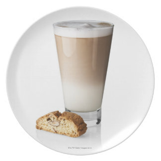Caffe latte with biscotti, on white background, plate