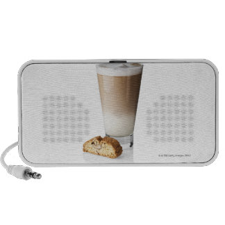 Caffe latte with biscotti, on white background, mp3 speakers