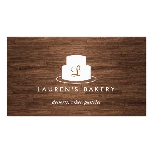 Cake Monogram Logo in White on Brown Woodgrain Business Card Templates