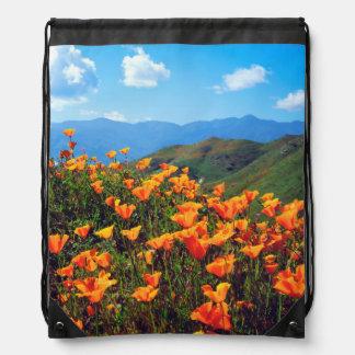 California poppies covering a hillside drawstring bag
