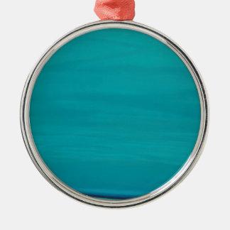 Calm beach. Silver-Colored round decoration