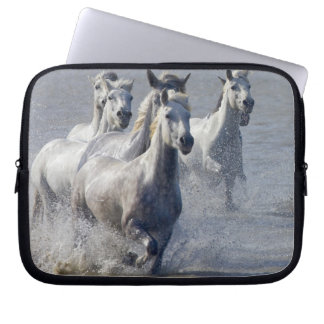 Camargue horses running on marshland to cross laptop sleeve