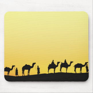 Camels and camel driver silhouetted at sunset, 3 mouse mat