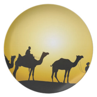 Camels and camel driver silhouetted at sunset, plate