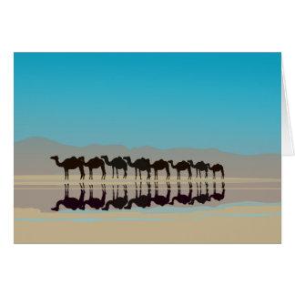 Camels walking in desert cards