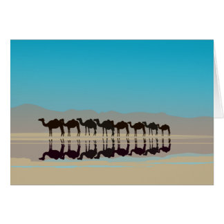 Camels walking in desert greeting card