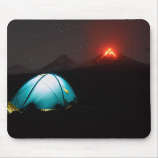 Camp tent at night on background of active volcano mouse mat