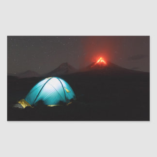 Camp tent at night on background of active volcano rectangular sticker