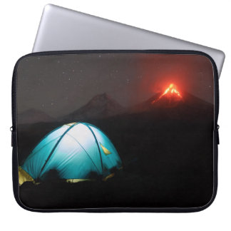Camping at night on background of active volcano laptop sleeve