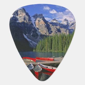 Canada, Alberta, Moraine Lake. Red canoes await Guitar Pick